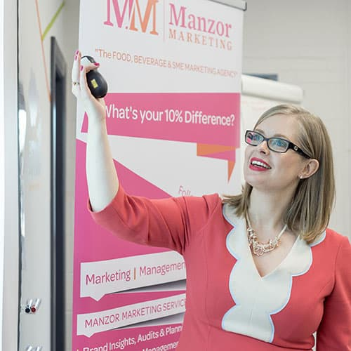 Jane Manzor pointing to a marketing presentation